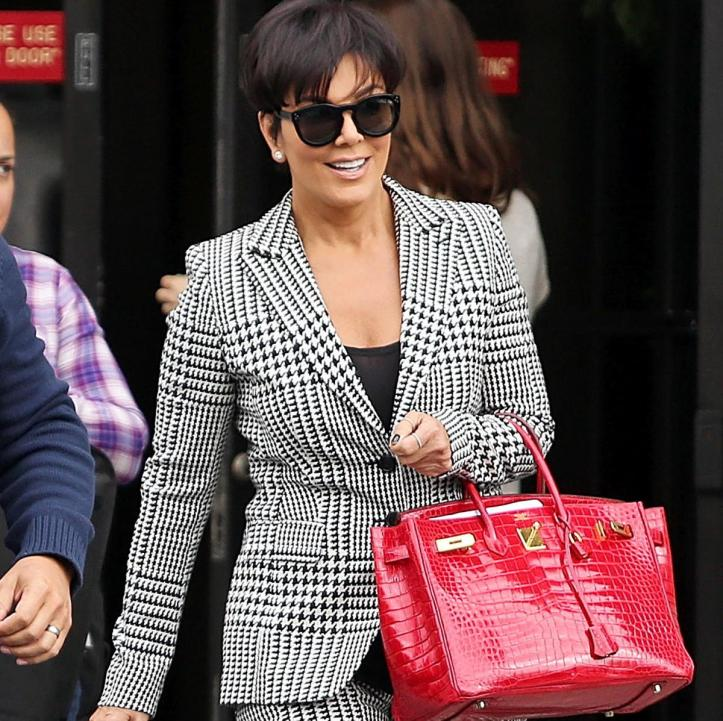 Kris Jenner, carrying her red Birkin bag