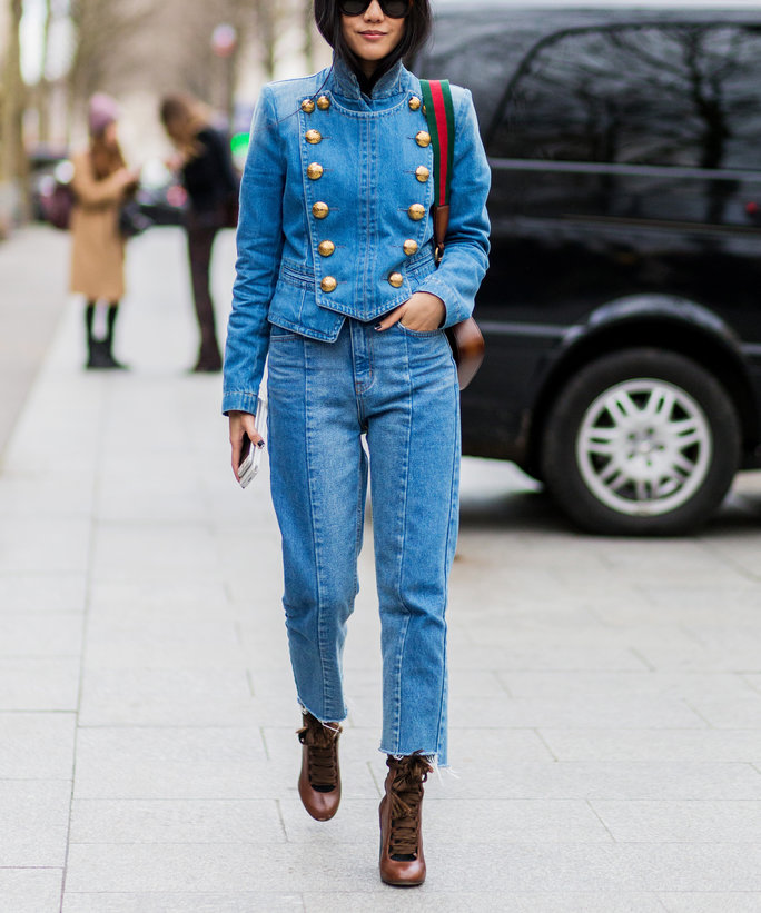 Yoyo Cao wearing a denim jacket and jeans and Gucci bag